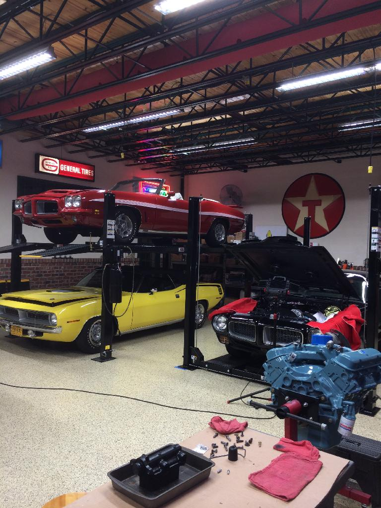 a car lift in your shop grumpys performance garage